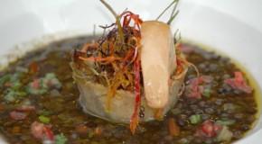 Saccottino di baccalà con la sua trippa, boccone di fegato d'anatra su brodetto di lenticchie nere dell'ennese